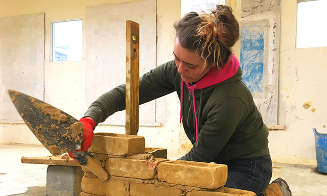 Student completing a level 1 bricklaying assessment